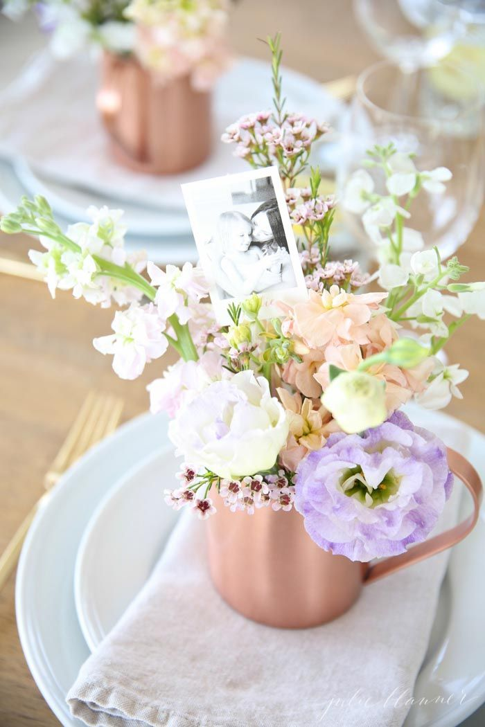 Beautiful Mother's Day brunch table setting idea with diy flower arrangements that double as take home favors