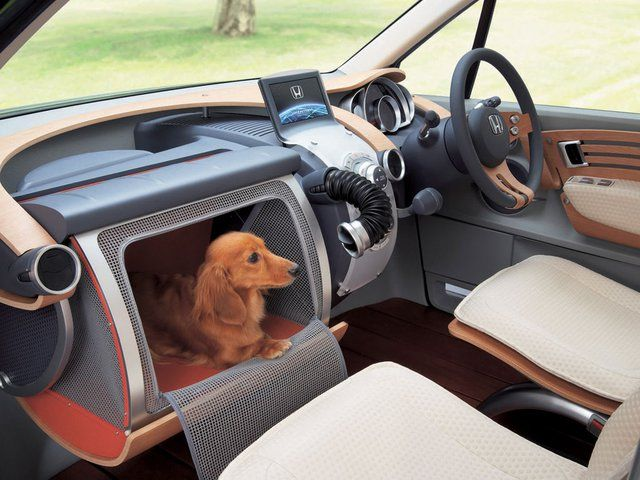 Honda W.O.W. In-Dash Dog Crate - really neat if you have a smaaaaall pup.