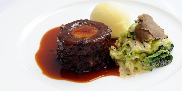 Stephen Crane's hearty oxtail recipe is served with boudin blanc and creamed cabbage, creating an exquisitely rich meal.