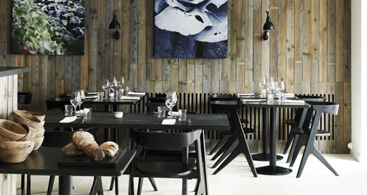 These walls are lined with weathered planks of salvaged wood from the island of Bornhalm - Claus Meyer wanted the dining room to focus on the essence of Nordic cuisine, and the natural world it comes from.
