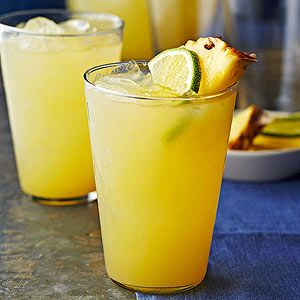 Pineapple-Ginger Punch - Grab a bottle of your favorite pineapple-flavor rum or vodka and get pouring! The infusion of sweet pineapple and zesty citrus juices in this punch is electric.