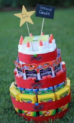 School Supply Cake as a Teacher's Gift:  crayon packs, glue stick packs, glue bottles, box of tissues, etc.  Notice the chalkboard painted sign on one of the sticks... incredible!
