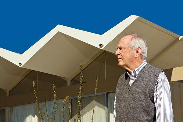 Donald Wexler in front of his folded roof house.