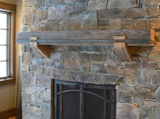 Gorgeous rock fireplace and mantel. I would place my wooden moose artwork on the mantel.