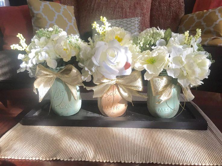 Coffee table arrangement using painted mason jars