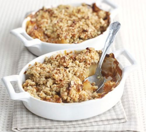 CARAMEL APPLE CRUMBLE ---- 8 eating apples  peeled, cored and cubed ;  6 tblsp Carnation caramel  cream (this comes in a can or a squeezy tube) ;  50g plain flour ; 50g porridge oat ; 50g cold butter diced