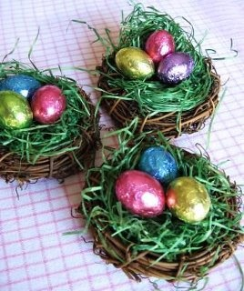 Easter-  Buy a pack of 6 mini wreaths from your local craft store, add grass and Easter candy...and voila'...use it as a place card holder or just a simple centerpiece in each plate