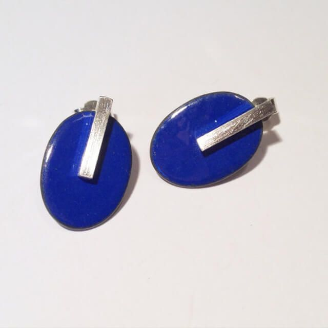 Gifts under £50  Lapis Blue Oval Studs  Beautiful, simple, lapis blue oval stud earrings.  Earrings are enamelled copper ovals with silver bars, silver posts and backs.   Earrings are made in a range of colours - if not listed don't hesitate to get in touch.  They can be made horizontally or vertically - picture shows vertical version.  The nature of enamel means that colours may vary making every pair of earrings completely unique!  I use enamel to convey colours from WWII stamps as well as…