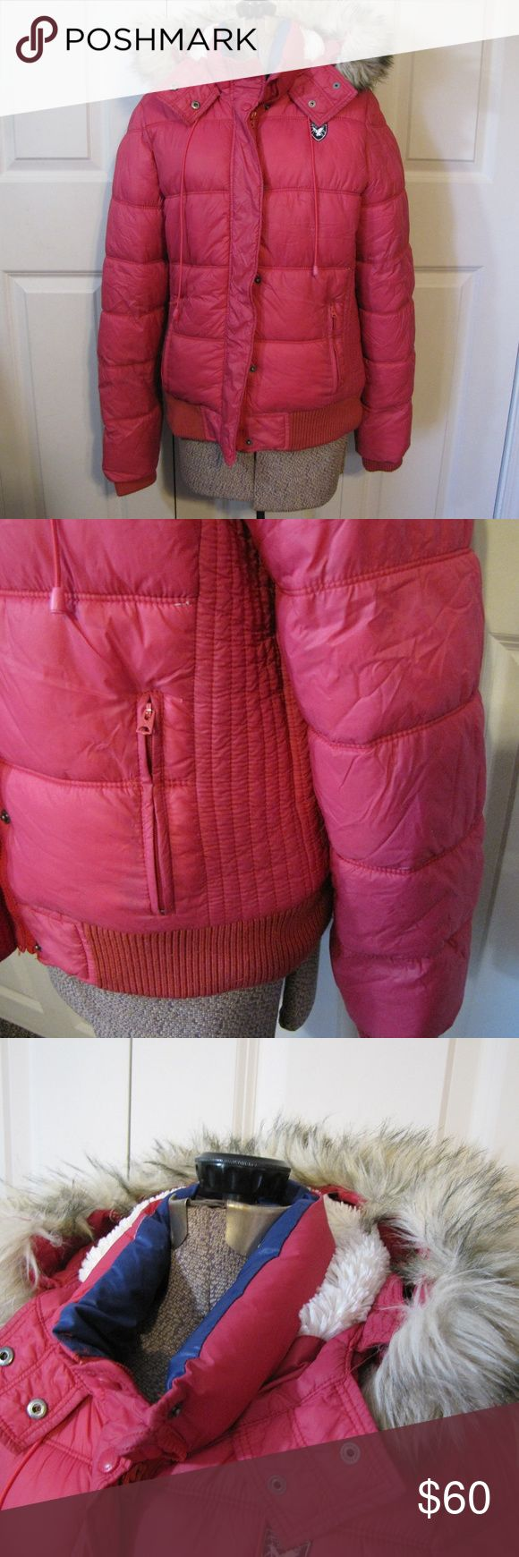 American Eagle Pink Puffer Fur Hooded Coat Excellent used condition American Eagle puffer. This baby is warm! The fur on the hood is not washable and is removable. There are two outer zipper pockets. A bit of piling on the sleeves and bottom. Sized XL. See pictures for materials. Measurements laid flat:  Armpit to armpit: about 19 1/2 inches Total length: about 25 inches American Eagle Outfitters Jackets & Coats Puffers
