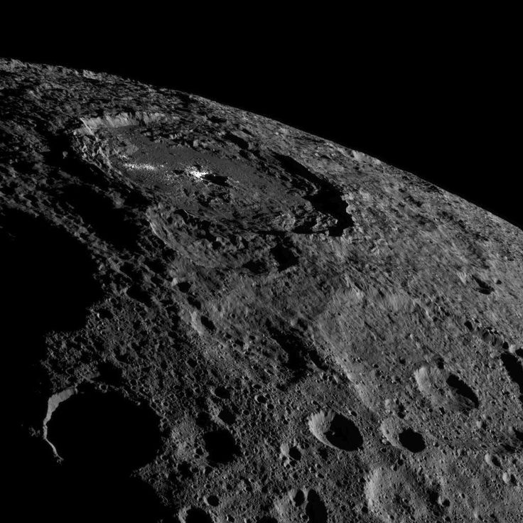 Occator Crater, home of Ceres' intriguing brightest areas, is prominently featured in this image from NASA's Dawn spacecraft.