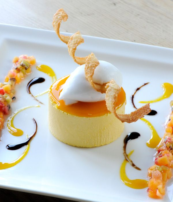 This summery mango parfait recipe from Mark Dodson will taste as good as it looks. The dessert is given an extra dimension by the inclusion of coconut sorbet but if you don't have an ice cream maker, the parfait can be served with a dollop of clotted cream or vanilla ice cream instead. - Mark Dodson