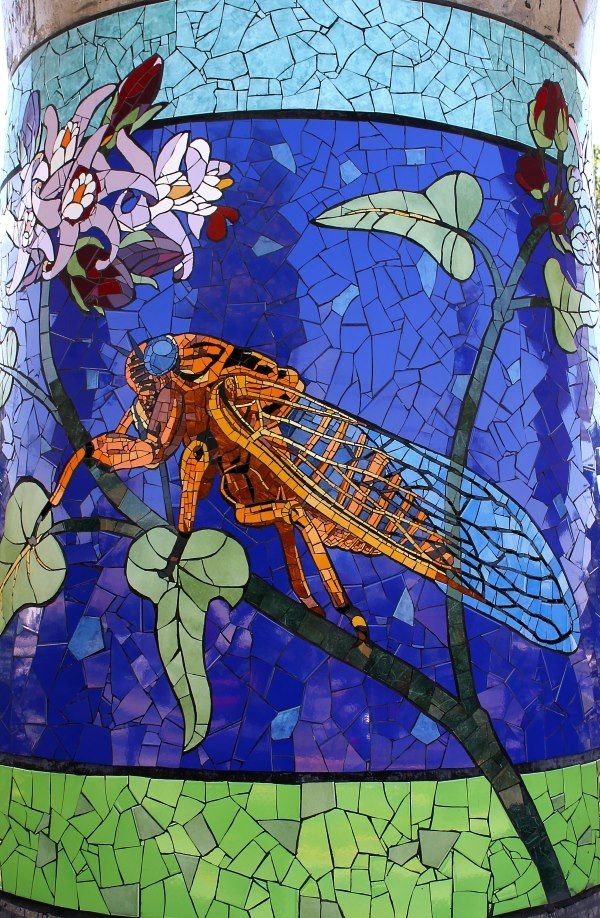 "Chicarra/Cicada ""Cicada chilensis"" on a pilar at a rail station in Puente Alto, Chile. Part of a huge mosaic project in the community."
