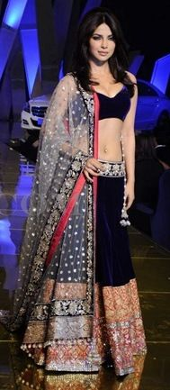 Bollywood actress Priyanka Chopra in beautiful designer lehenga style saree with embroidered sequins buttes and lace border work paired with designer sleeveless saree blouse with 'V' shape neck pattern from designer Manish Malhotra at People's Best Dressed Unveiling 2011.It is a shimmer Material.