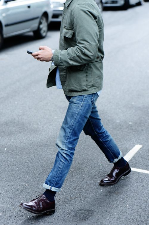 Utilitarian jacket, pale blue button-down, pair of perfectly broken-in jeans, and amazing cap-toe oxfords. Photo: Tommy Ton