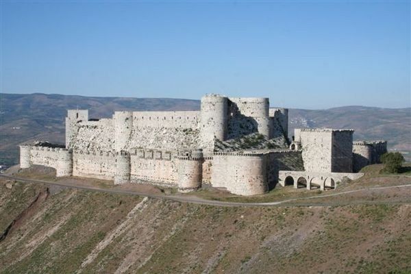 Krak des Chevaliers (Syria). Although Krak never belonged to the Templars, it is one of the best preserved crusader castles, and gives an idea of the overwhelming size and power of crusader fortifications (mid-1100s).