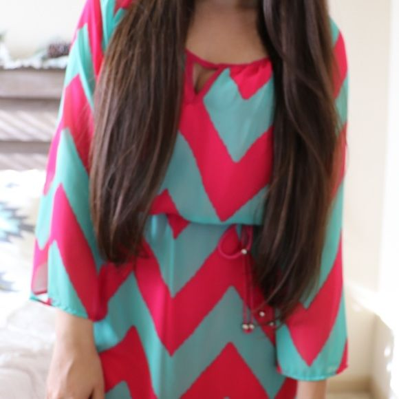 FINAL SALE! Pink & Mint Chevron Dress This beautiful hot pink and mint green chevron dress is so comfy and cute! Brand new! Perfect if you're on the shorter side!  🌷 Sheer long sleeves 🌷 Has a slip underneath  🌷 Ties at the waist 🌷 Small cutout right under the neck  🌷 Stretchy waist 🌷 Very flattering!  🌷 100% polyester a'gaci Dresses