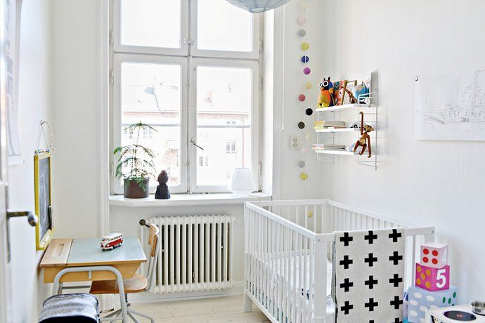 white nursery with pops of colors