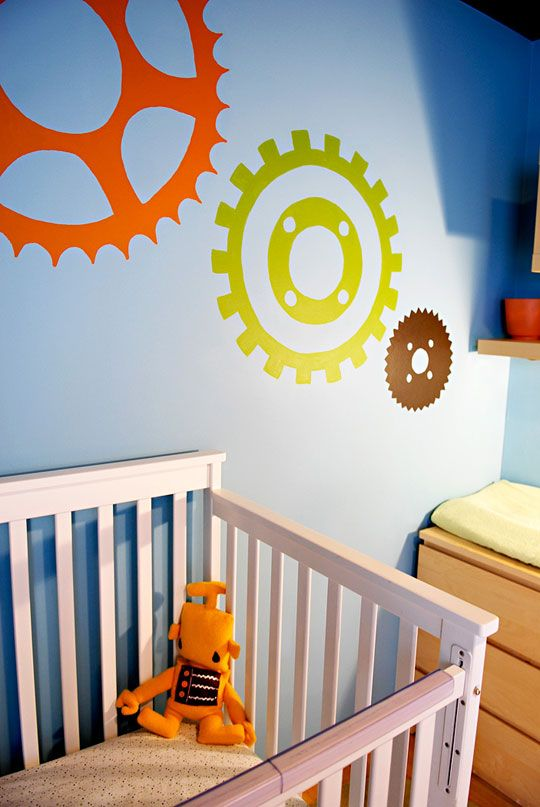 The gears and cogs on the wall are perfect for a robot nursery... I'm also digging the wall color :)