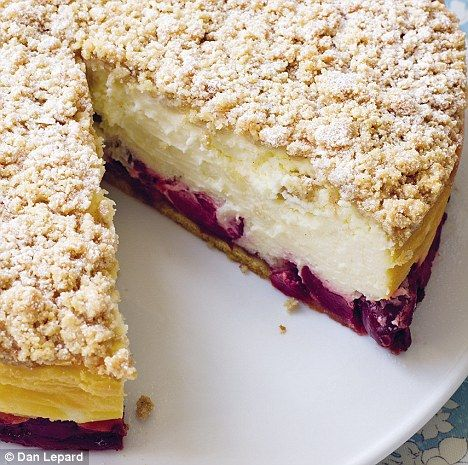 Cherry Crumble Cheescake - dense creamy texture, the sponge base becomes gooey as it soaks up the juices from the cherries yet the top has a crunchy sweet crumble; tastes superb.