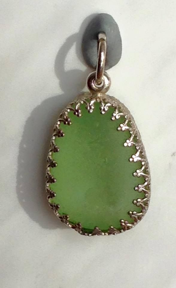 Bezel set English sea glass gem - backless bezel - its the same on the front as the back.  Available for purchase on Sea & Shore. https://www.facebook.com/groups/beachcrafts/