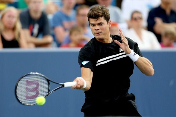 Milos Raonic of Canada returns a shot to Jack Sock during the Western & Southern Open on August 13, 2013 at Lindner Family Tennis Center in Cincinnati, Ohio
