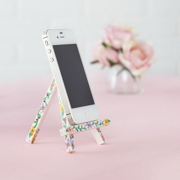 iPhone Easel. Paint the easel with acrylic paint and use sharpie markers to draw floral pattern on it for beautiful garnishment. <3