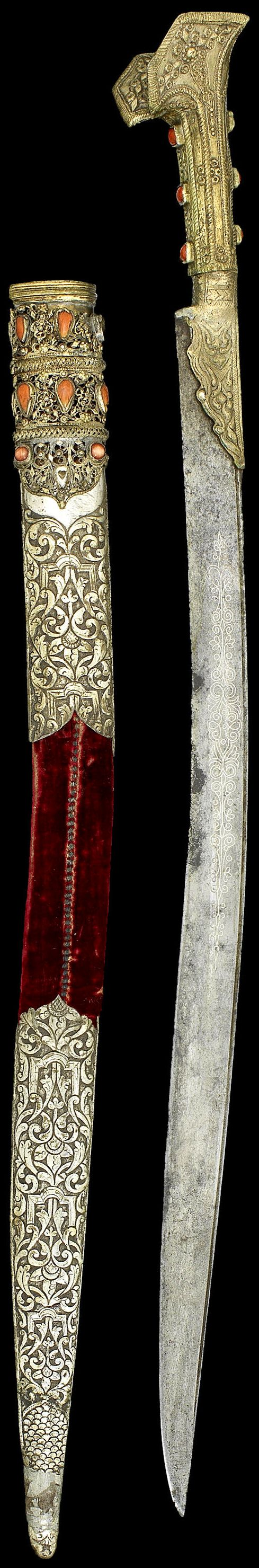 Ottoman yataghan / yatagan, AH 1220/ AD 1805-6, steel blade decorated with silver inlay with floral and vegetal motifs on one side and inscriptions on the other, the hilt with prominent ears forming the pommel cast with circular motifs and set with glass, the scabbard clad with elaborately embossed rococo style silver at top and bottom with coral, 76 cm, inscribed with the names of the Seven Sleepers and their dog. The owner's name, Mustafa bashi ibn Ahmad. 'The work of 'Abdallah [?]'.