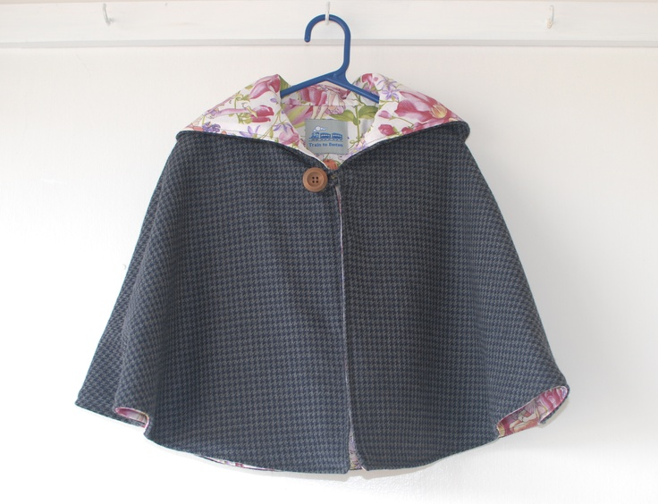 Pink Fairy Cape.  100% wool tweed with a cotton lining.  We love this combo.