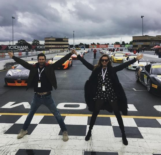 "Adam Levine and Behati Prinsloo race track. Adam Levine and Behati Prinsloo struck a pose on a racetrack in April 2016. ""Ferrari heaven. We should probably get out of the way now though,"" he captioned this snapshot. - Behati Prinsloo and Adam Levine's cutest Instagrams."