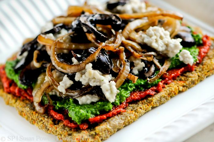Raw Pizza with Buckwheat Crust with Marinated Mushrooms and Onions, Marinara Sauce, Spinach  and Walnut Pesto and Cashew Cheese. (Vegan and Raw.)