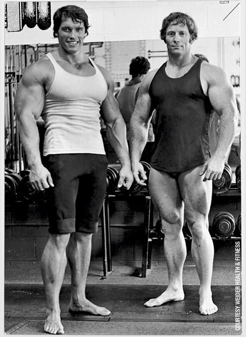 Arnold with Mr. Universe winner Ken Waller at the original Gold's Venice. As massive as Ken was, compare Arnold's arms and chest.