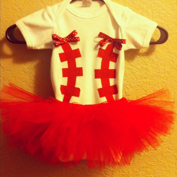 Baseball baby onesie and tutu outfit With matching bow in sizes 0-3mo, 3-6mo, 6-12mo, & 24mo. $35.00, via Etsy.