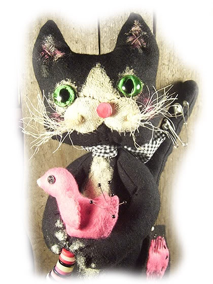 Painted muslin cat with felt bird pin cushion.
