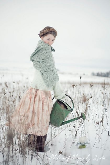 simple lace shawl + pretty hair and clothing... lovely photo.  (but why a watering pitcher in the winter?)