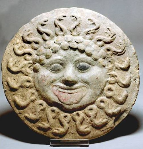 Medusa antefix, 4th century B.C. Medusa antefix, Greek terracotta antefix, Canosan, Greek polychrome antefix showing the facing head of Medusa with traces of original black, pink and white pigments surviving, the serpents particularly well represented, 21 cm diameter. Private collection