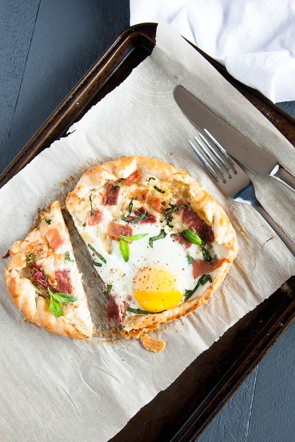 A cheesy Breakfast Galette wrapped in sour cream pastry with an egg baked onto it - a special weekend brunch!