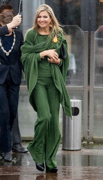 Queen Maxima of The Netherlands opted for a block colour of an olive green co-ord set from Dutch brand Jantaminiau complete with matching shawl for her engagement in Amsterdam.