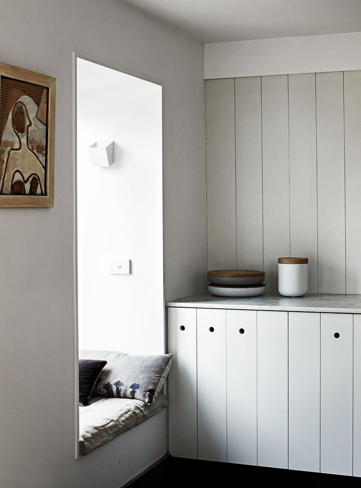"""The cladded kitchen cupboards keep the space functional yet uncluttered. """"We used Baltic pine tongue-and-groove floorboards (19mm) for internal cladding and then painted them a soft white,"""" Carole says."""