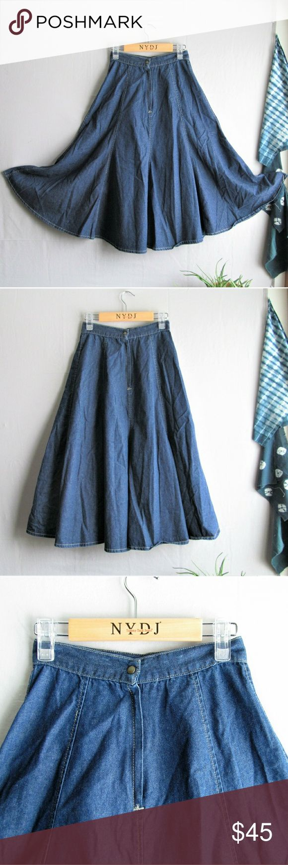 """Vintage Sears 70s full flared denim midi skirt This skirt is amazing!! Vintage 1970s sears catalog full denim skirt in midi length, medium wash, with an even fuller flared hem... stunning snap closure at the natural waist. There is no stretch, this skirt was made to fit an almost wasp waist silhouette. Fits an xxs to an xs. Please refer to measurements♡  Measurements taken flat  Waistband 12.75""""  Length 30.5""""  Get ready to be featured on a fashion blog when you wear this out. I'm serious…"""