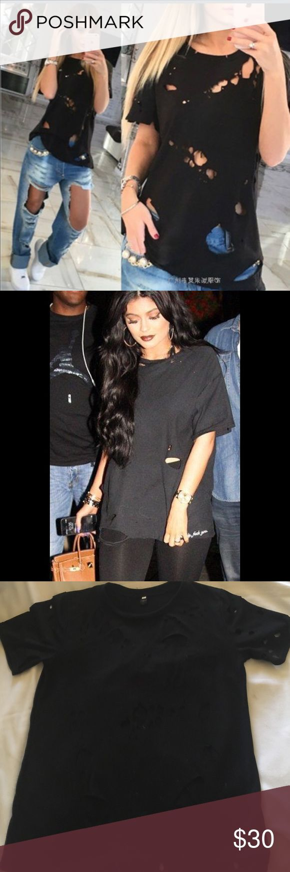 Black t-Shirt holes. Shirt is made this way. Black t-shirt with holes. Shirt is NWOT.  Made this way not diy.  Like seen on Kylie Jenner Shy Land Tops Tees - Short Sleeve