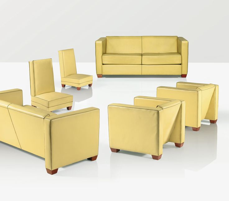 D'après Boris Lacroix MOBILIER DE SALON, 1985 A YELLOW LEATHER AND LACQUERED WOOD SUITE, COMPRISING TWO SOFAS, TWO LOUNGE CHAIRS AND TWO CHAUFFEUSES, AFTER A DESIGN BY BORIS LACROIX, 1985. THE LACQUER WORK BY BERNARD DUNAND THIS SET WAS EXECUTED LATER, AFTER THE MODEL DESIGNED CIRCA 1928 FOR MADELEINE VIONNET