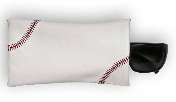 This baseball sunglass pouch is created from actual baseball leather, and features red baseball stitching. If you love baseball, use the only sunglass pouch made from actual baseball material with real red stitching accents! Fits easily into any purse or bag.