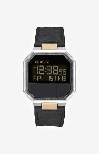 Online Only! Nixon adds a dose of retro to your watch game with the The Re-Run Leather Watch. This stylish digital watch boasts a stainless steel case, a genuine leather strap, and multi-function capabilities such as alarm, calendar, and countdown timer.   	Multi-function digital watch 	LCD negative or positive display 	Stainless steel case and caseback 	Genuine leather strap 	Calendar, dual time, alarm, countdown timer, and light functions 	Imported