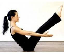 pinsonia kumar on vinyasa  yoga poses boat pose