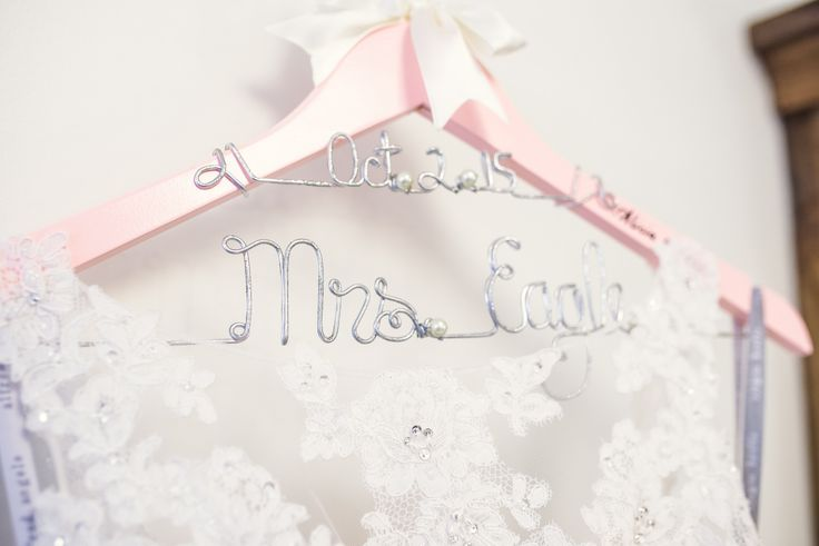 A personalized hanger with your new last name is the perfect accessory for your wedding dress | Bridal Suite at ceremony and reception venue | Bridesmaid gift | Photography: Melissa Avey