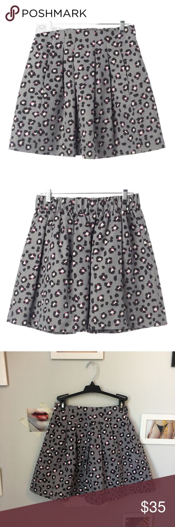 "Kate Spade Gray Cheetah Print Skirt kate spade cheetah print skirt • size 0, elastic stretch waist • features soft pleats with two hidden pockets at the waistband • length is 16.25"" • waist measures 12.5"" laying flat, can comfortably fit a 25-27 • fully lined • 77% cotton / 23% polyester  ✨ please note - you will be blocked if you offer anything more than 20% off the listed price, most prices are firm unless otherwise noted - thank you ✨ kate spade Skirts Mini"