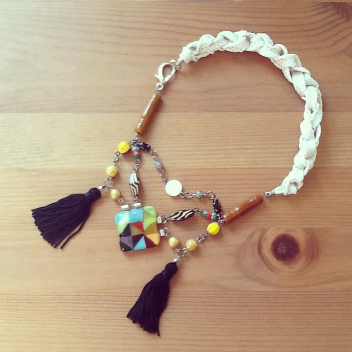 Recycled glass pendant with beads and tassels