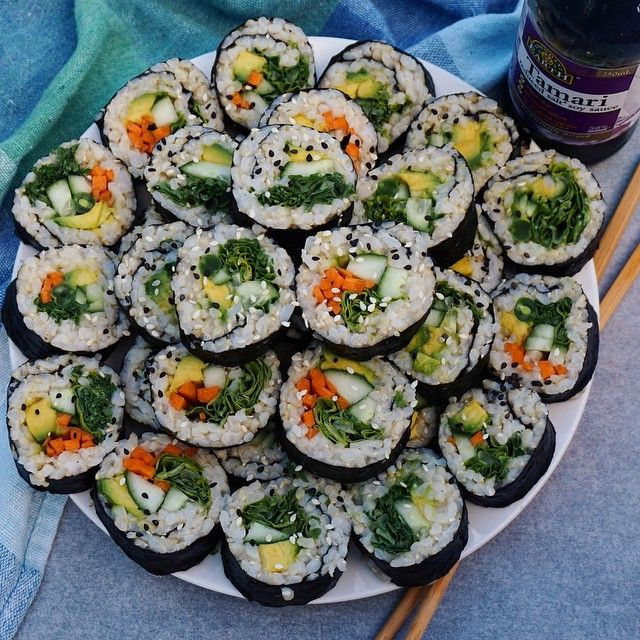 insp// cucumber, carrot, spinach, avocado, sushi rolls with sesame seeds.