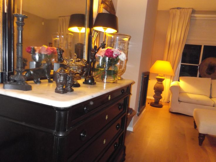 Bronzes on antique chest of drawers