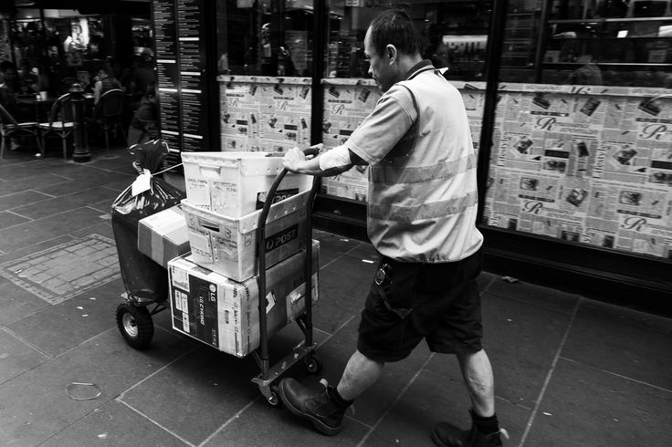 I like this image, you can see the sheer amount of packages that he has to deliver and again, his sole focus is on the job at hand - ignoring everything else in the environment.